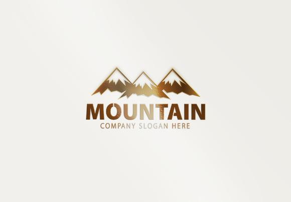 yellow sun over green mountain restaurant logo