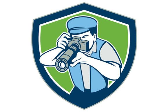 Photographer Shooting Camera Shield