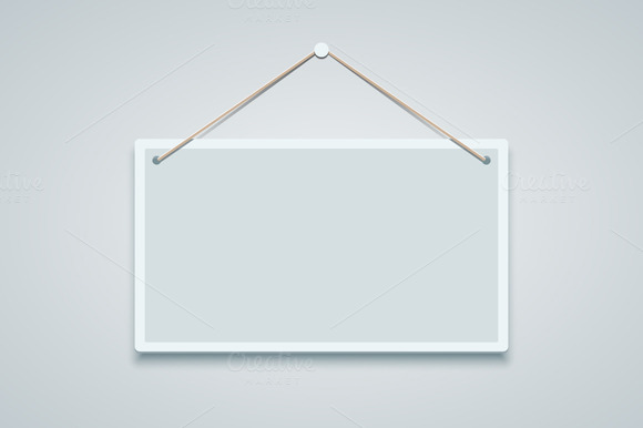 Blank Sign Board Hanging On The Wall
