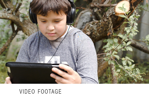 Boy In Headphones With Touchpad