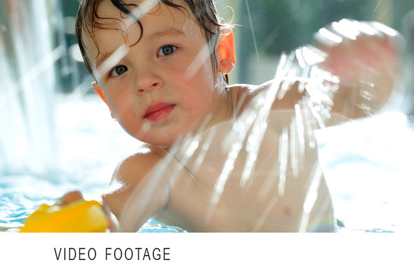 Boy In The Swimming Pool Splashing