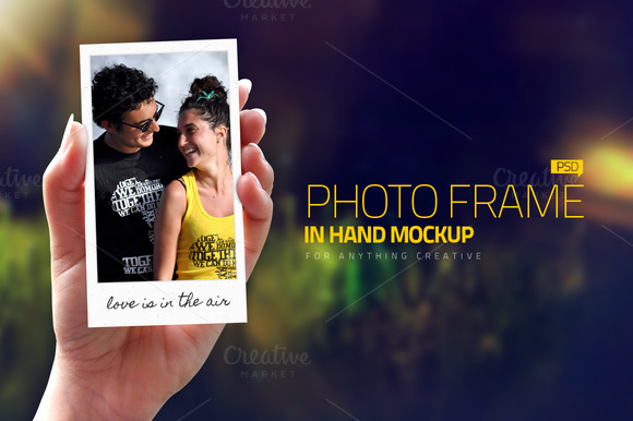 Photo Frames In Hand Mockups