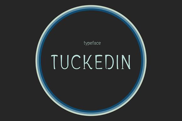 TUCKEDIN