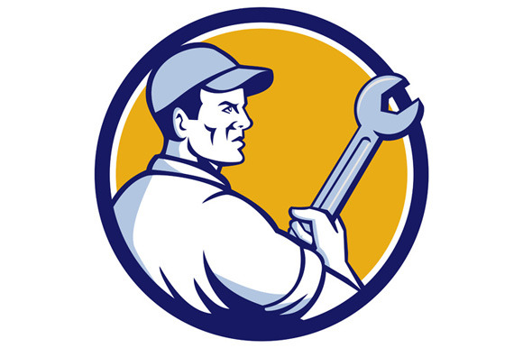 Mechanic Holding Monkey Wrench