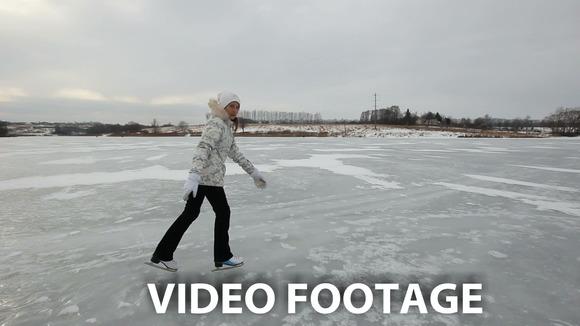 girl ice skating on frozen lake - Graphics