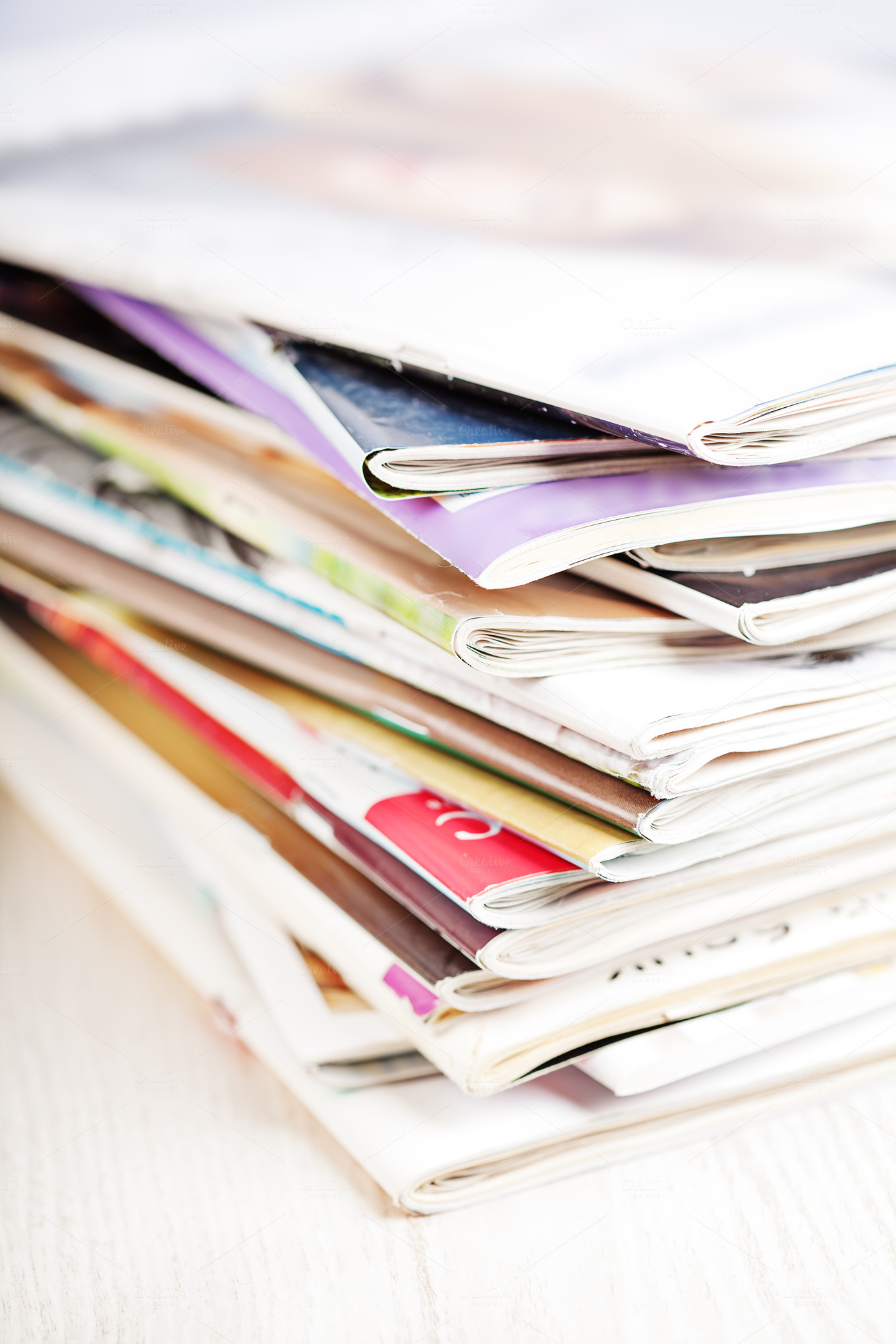 stack of magazines on white table