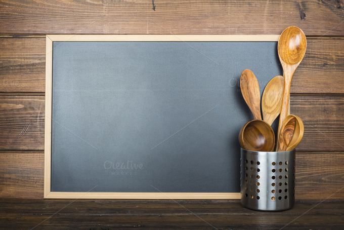 An Empty Chalkboard With A Space For Text And Some Cooking Utensils