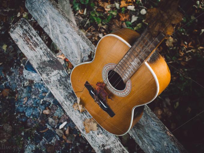 an old broken acoustic guitar arts entertainment photos on creative market. Black Bedroom Furniture Sets. Home Design Ideas
