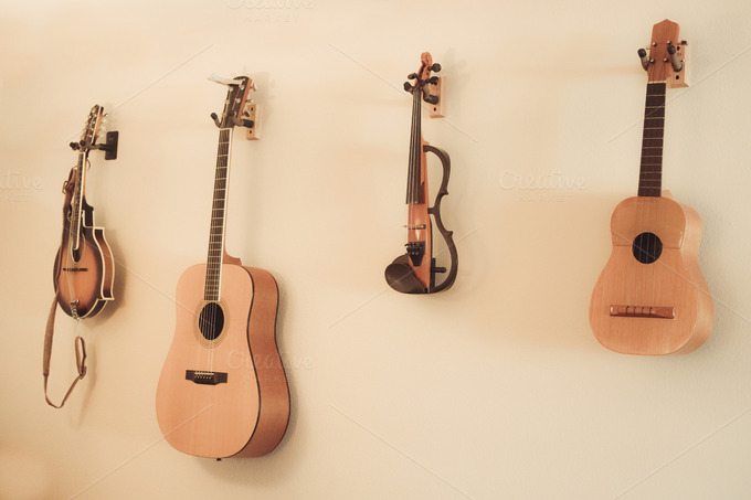 string instruments hanging on wall arts entertainment photos on creative market. Black Bedroom Furniture Sets. Home Design Ideas