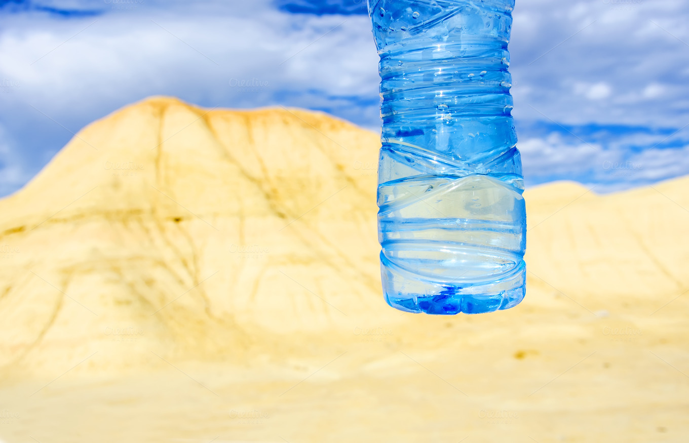 Bottle of water in the desert ~ Food & Drink Photos on ...