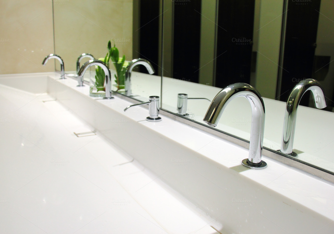 sinks and taps in a public toilet ~ Health Photos on Creative Market
