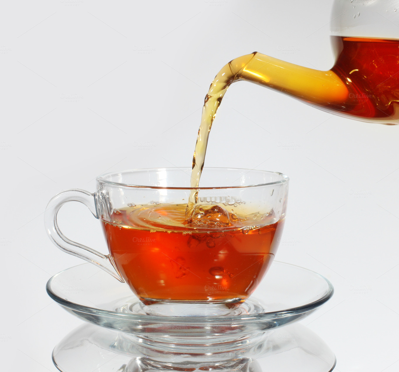 Pouring tea to a teacup ~ Food & Drink Photos on Creative ...
