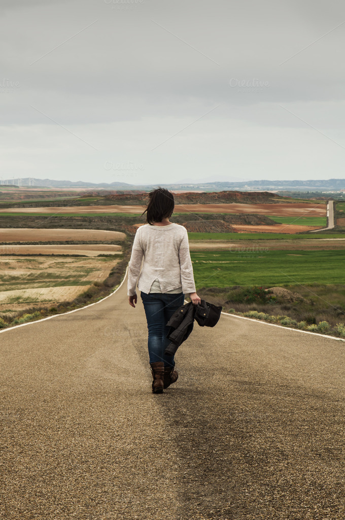 Woman walking alone in a road ~ Nature Photos on Creative ...