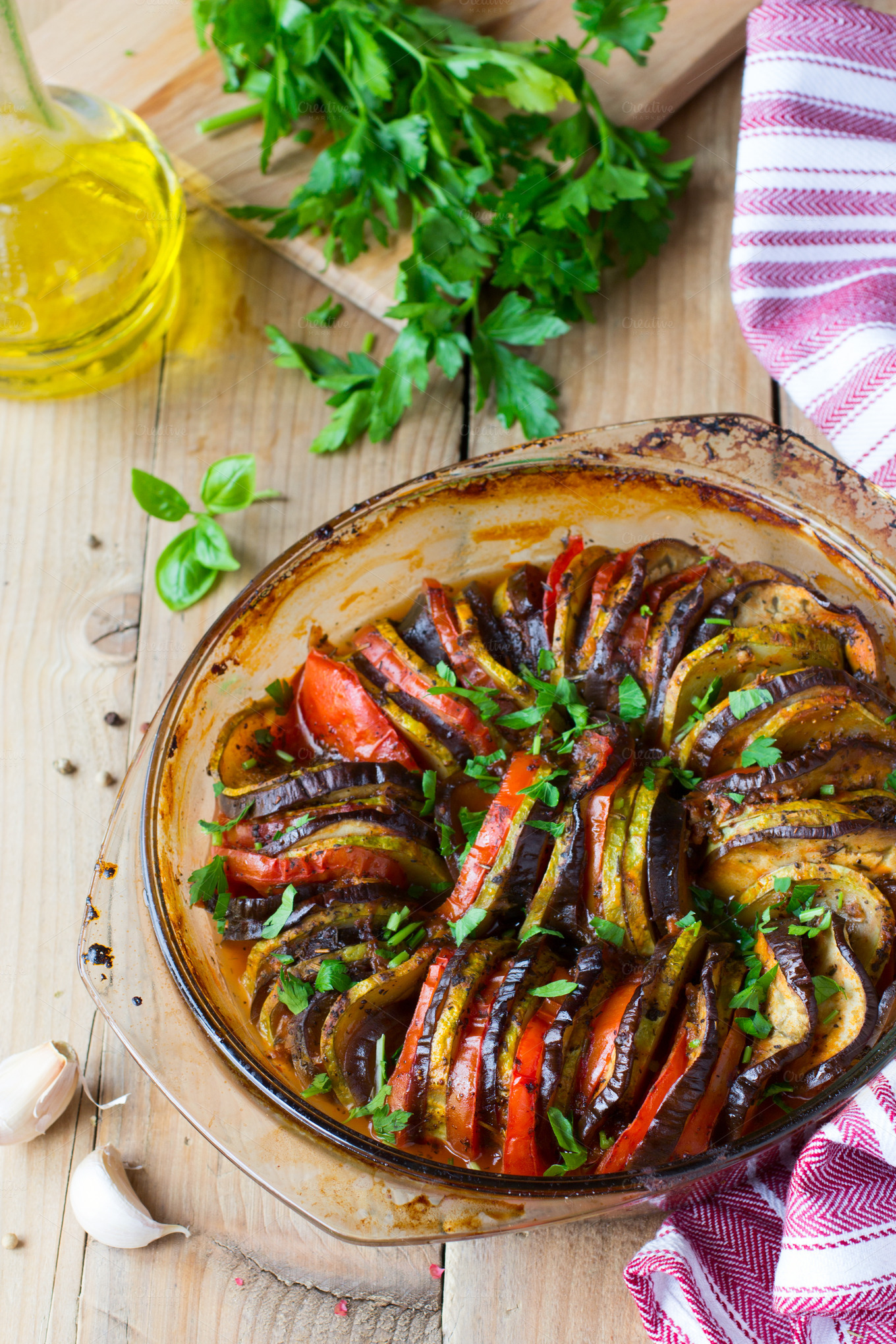 Ratatouille on rustic table ~ Food & Drink Photos on Creative Market