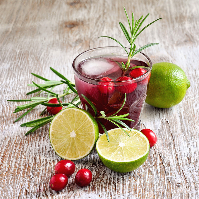 cranberry drink with rosemary, lime, and ice cubes, summer cocktail ...