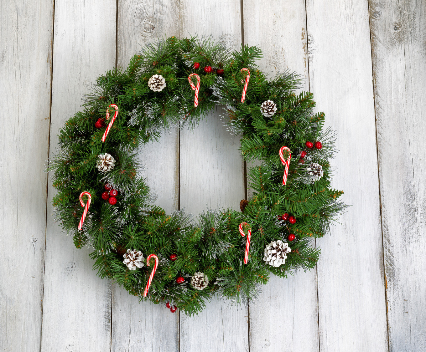 Christmas wreath on old white wood holiday photos