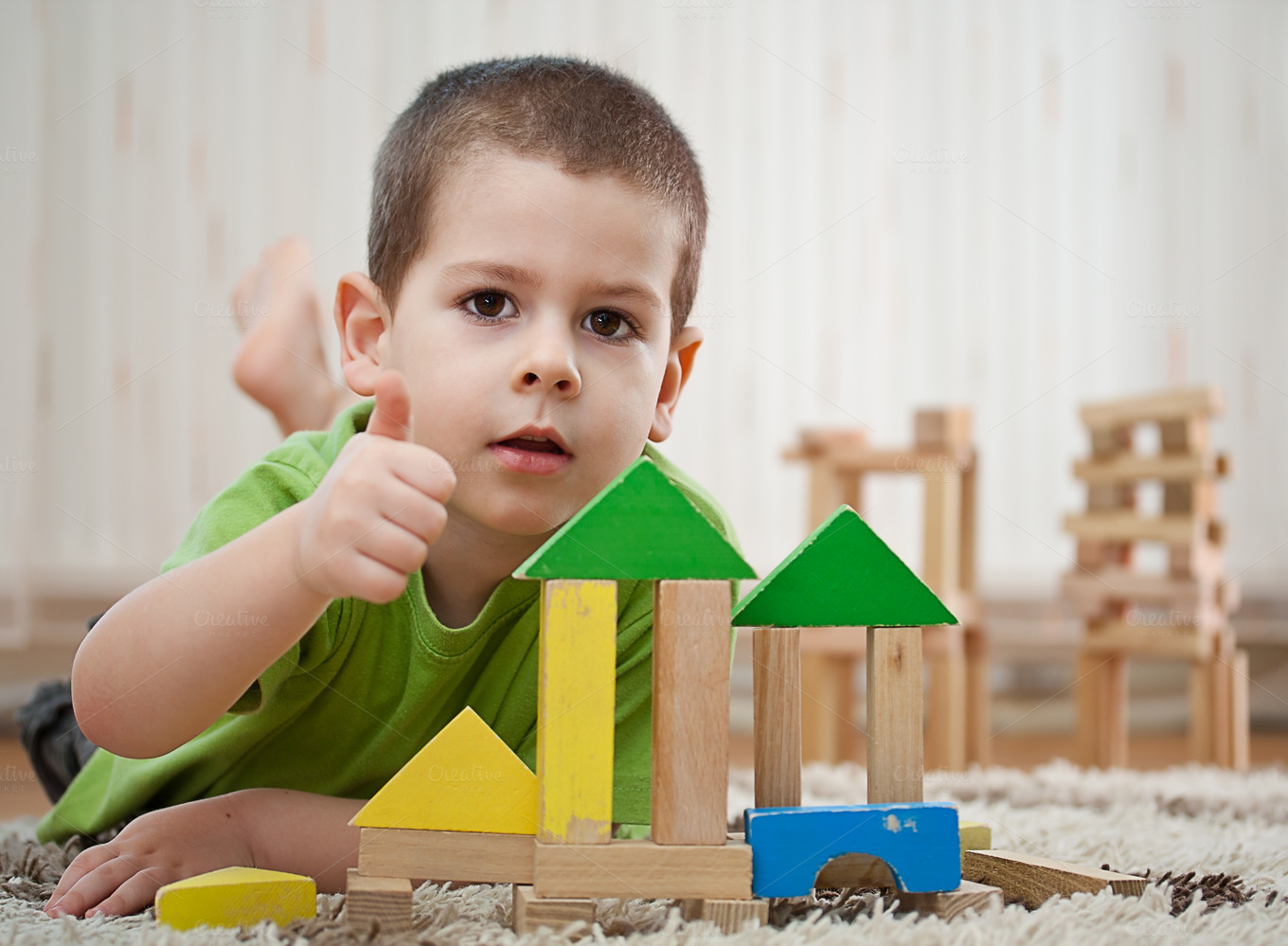 Boy playing with blocks ~ People Photos on Creative Market