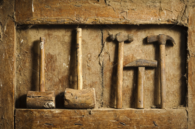 Old Tools On Antique Wooden Panel