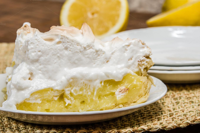 Slice of homemade lemon meringue pie ~ Food & Drink Photos on Creative ...