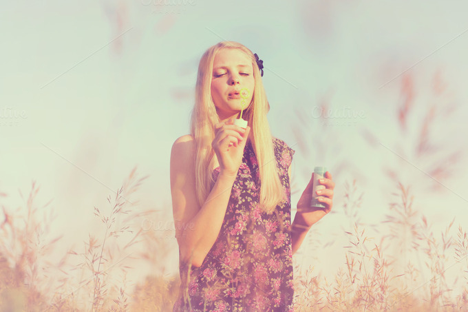 Girl Blowing Soap Bubbles Girl Blowing Bubbles