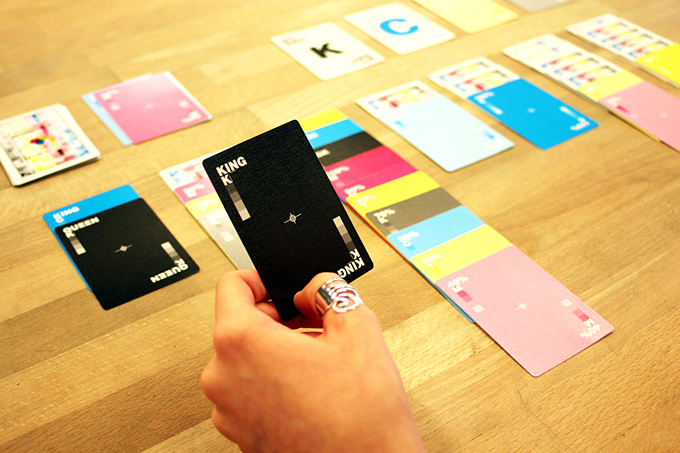 CMYK playing cards laid out