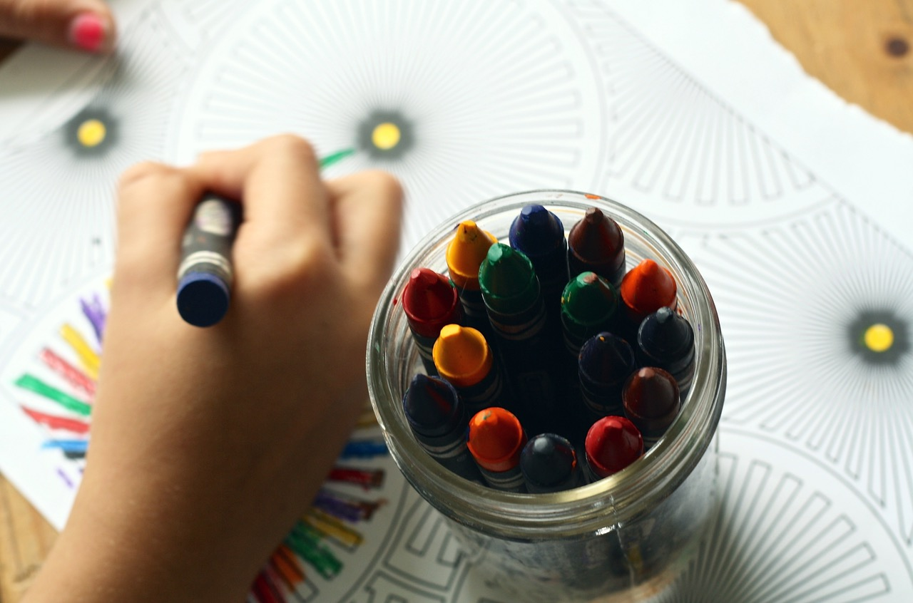 crayons on the drawing table